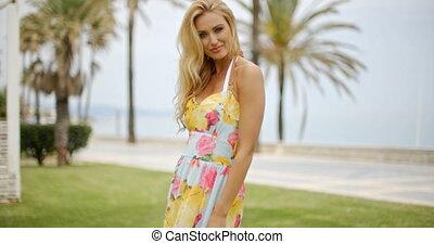 Woman in Sun Dress at Ocean Front Promenade