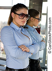 woman in sunglasses and mirror