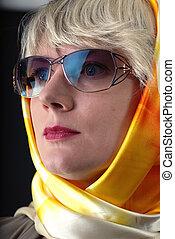 woman in sunglasses and neckerchief