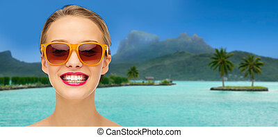 woman in sunglasses over bora bora beach