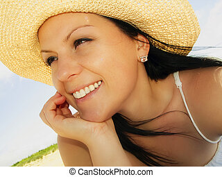 woman in sunhat on the beach