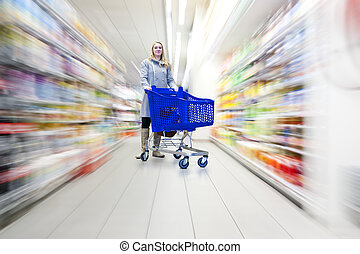 Woman in supermarket - Confident woman with her shopping...