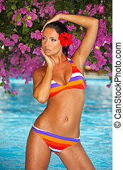 Woman in swimming pool - 20-25 years woman portrait in...