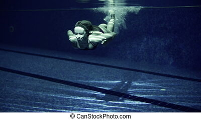 Woman in Swimming Pool - Underwater shot of woman floating...