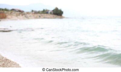 woman in swimsuit on sea beach