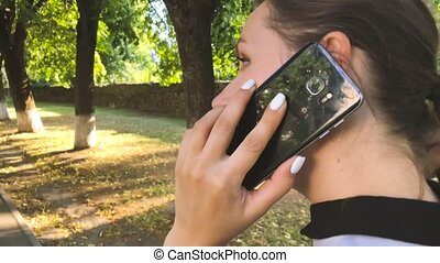 Woman in talking on the smartphone and emotionally...