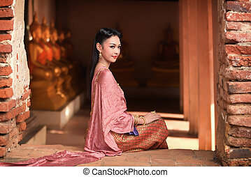 Woman in Thai dress traditional