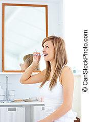 woman in the bathroom brushing