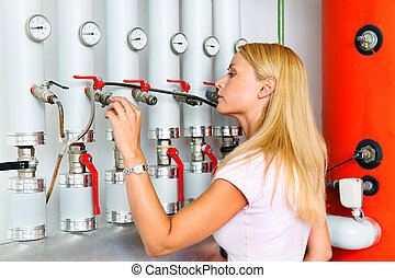 Woman in the boiler room for heating.