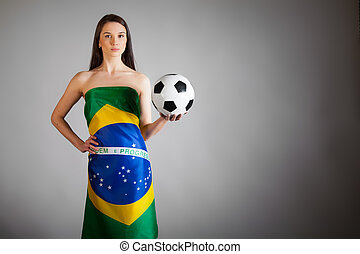 woman in the Brazilian flag and soccer ball