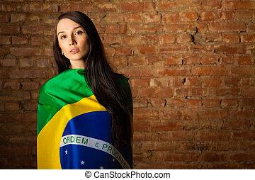 woman in the Brazilian flag