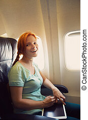 woman in the chair on board aircraft