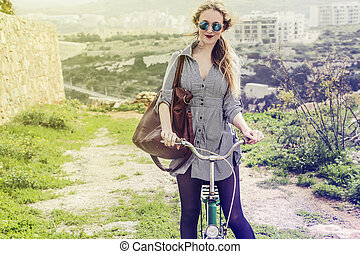 Woman in the city with bike