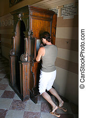 Woman in the confessional