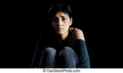 woman in the dark crying - Young woman in the dark touching...