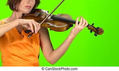Woman in the dress plays a violin. Green screen - Woman in...