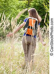 Woman in the field of rye
