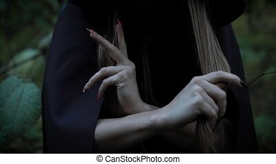 Woman in the forst scares with her sharp nails. - Creepy...