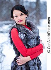 Woman In the fur vest