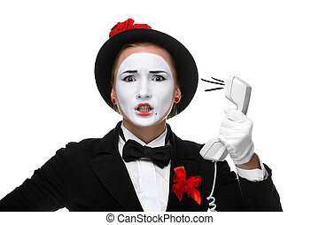 Woman in the image mime holding a handset.