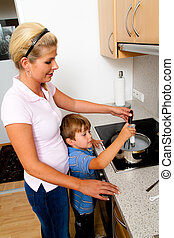 Woman in the kitchen cooking with electric