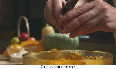 Woman in the kitchen making a pumpkin pie. 4k, slow-motion shooting. dolly shot