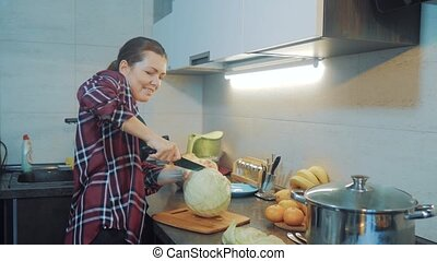 woman in the kitchen preparing a meal concept. girl in the...
