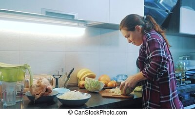 woman in the kitchen preparing a meal concept lifestyle ....
