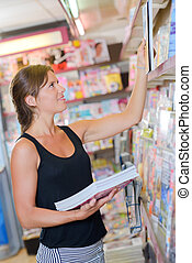 woman in the magazine shop