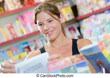 woman in the magazine store