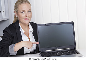 woman in the office with laptop computer