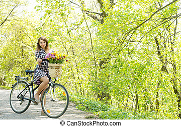 Woman in the park on a bike