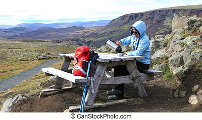 Woman in the picnic area - Woman sitting at a table in the...