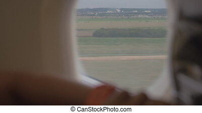 Woman in the plane setting watch ahead