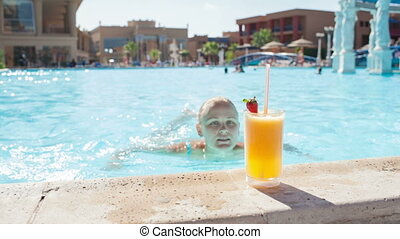 Woman in the pool with juice