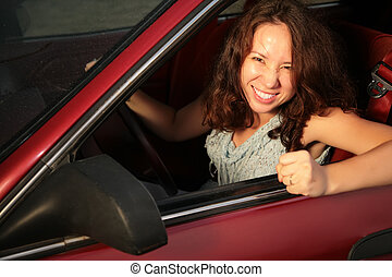 Woman in the red car