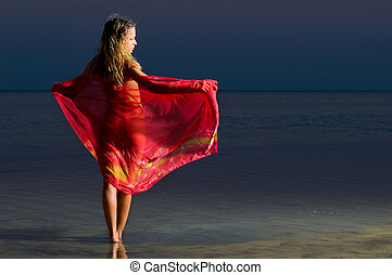 woman in the red on the beach