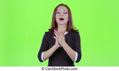 Woman in the theater claps bravely to the actors. Green...