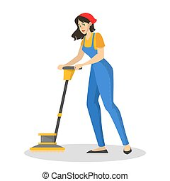 Woman in the uniform cleaning floor using vacuum cleaner