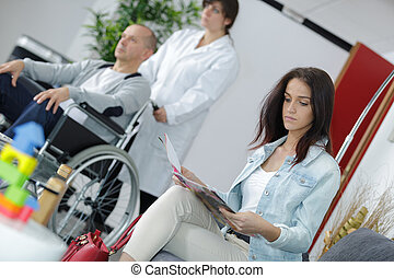 woman in the waiting room of a hospital