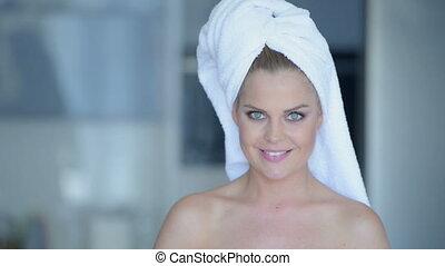 Woman in towel drinking juice