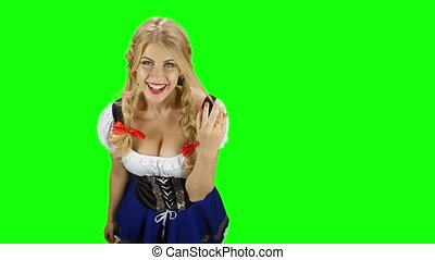 Woman in traditional costume offers a glass of beer on oktoberfest. Green screen