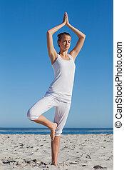 Woman in tree yoga pose