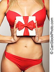 Woman in underwear holding gift