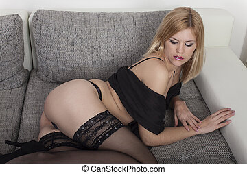 woman in underwear on a couch