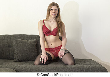 Woman in underwear - A pretty brunette young woman in...