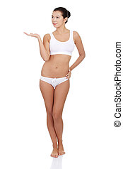 Woman in underwear presenting something