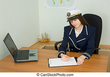 Woman in uniform sailor in office