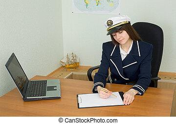 Woman in uniform sailor in office