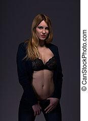 Woman in unzipped jeans